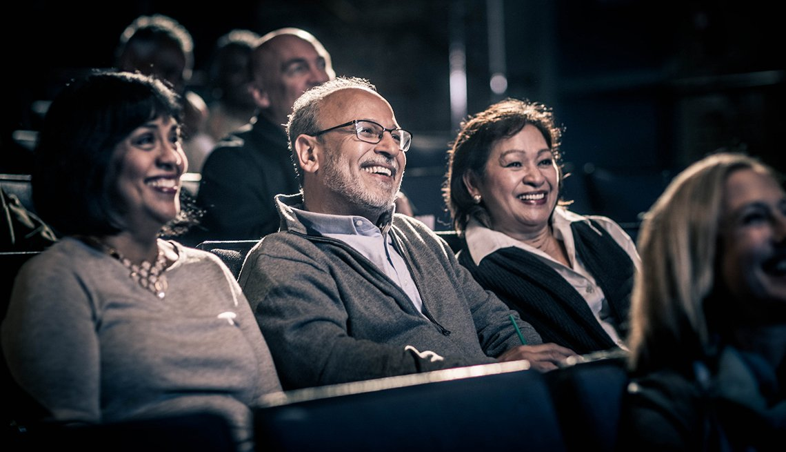 Three adults sitting in a movie theater