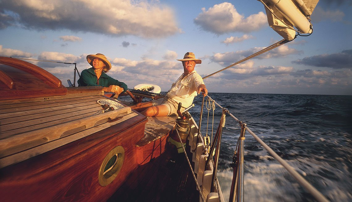 Mature Couple Sailing Vintage Yacht off Florida, AARP Member Benefits Insurance