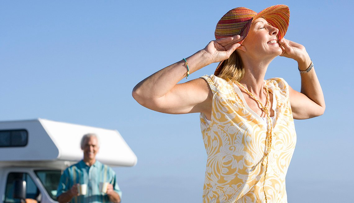 Mature Woman with Husband near Recreational Vehicle on Beach, AARP Member Benefits Insurance