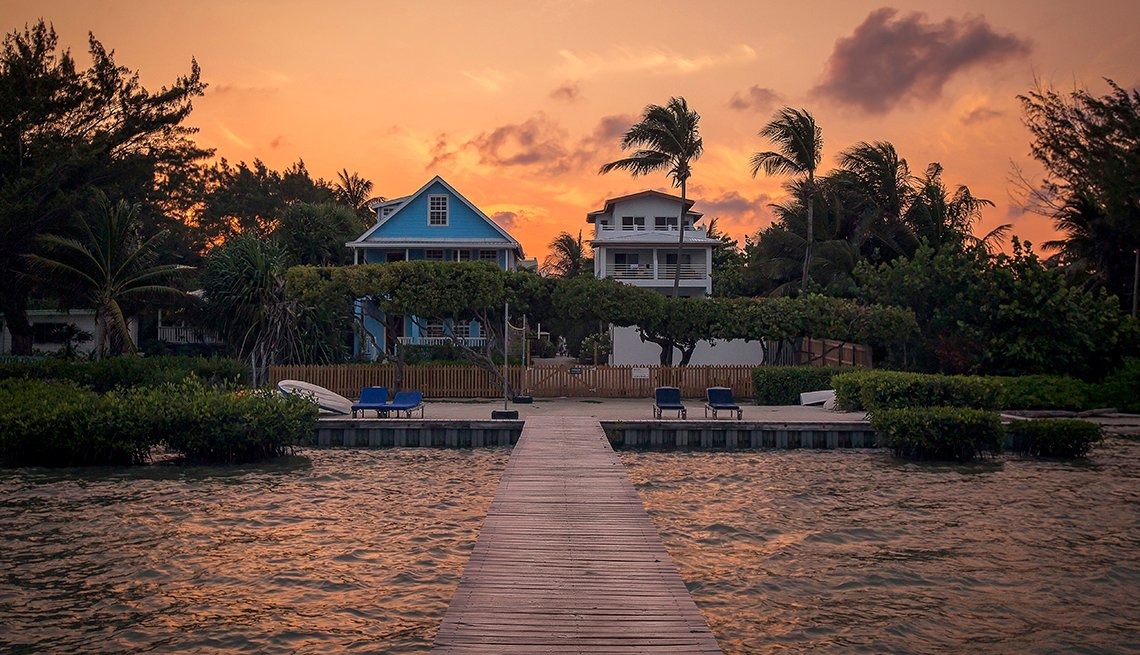 Houses on Jetty Over Lake In Belize at Sunset, AARP Member Benefits Insurance