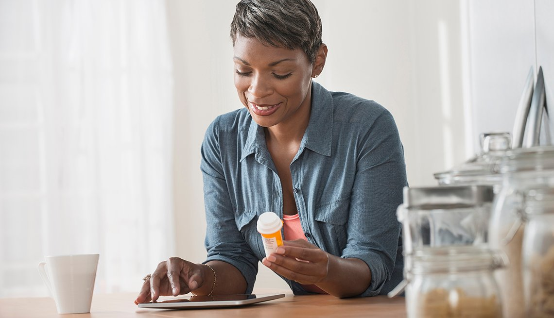 African American Woman Researches Prescription Medicine AARP Member Benefits Insurance