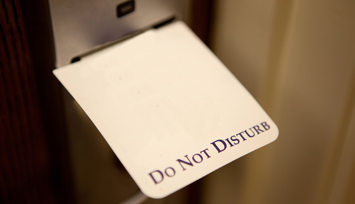 Do Not Disturb Sign on Hotel Room Door, AARP Member Benefits Hotel Spotlight