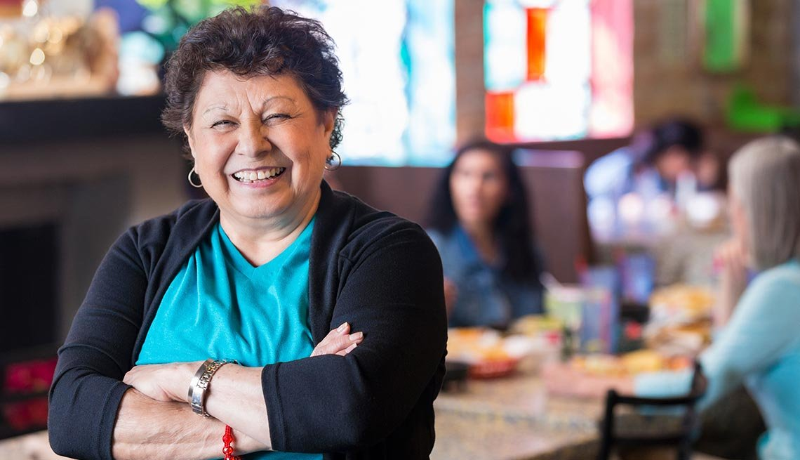 Woman smiling, family-owned restaurant, Work for Yourself 50+, AARP Foundation