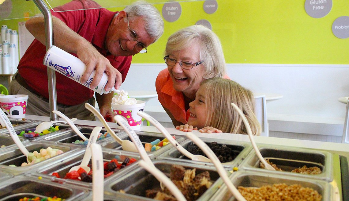 sweetFrog, grandparents putting on toppings