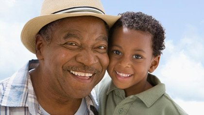 grandfather with smiling grandchild