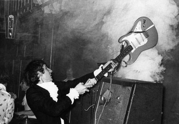 Pete Townshend of The Who performing live onstage, smashing guitar against amplifier - Pete Townshend Retrospective