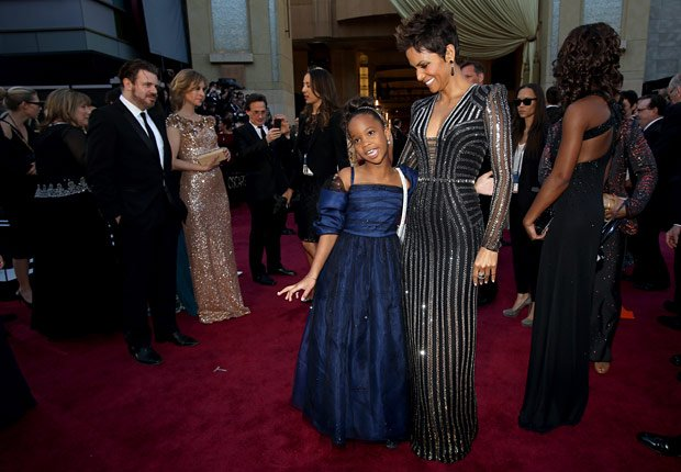 Actresses Quvenzhane Wallis, left, and Halle Berry arrive at the 85th Academy Awards