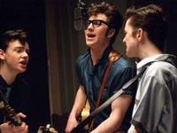 Aaron Johnson as John Lennon (center), in <i>Nowhere Boy</i>, 2009
