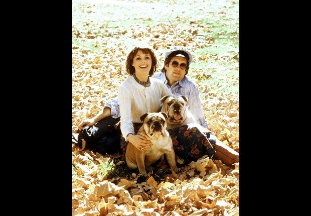 Captain and Tennille pose outdoors with their two bulldogs.