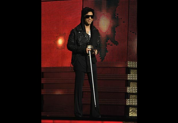 Prince presents the award for record of the year on stage, Grammy Awards 2013