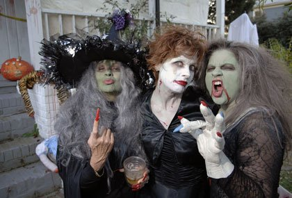 Three witches at a Halloween party