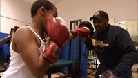 Junious Hinton spars with young boy