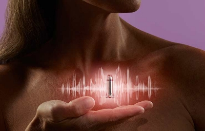 Woman holding pacemaker with light glowing out of it, Medical Breakthroughs and Miracles ESP