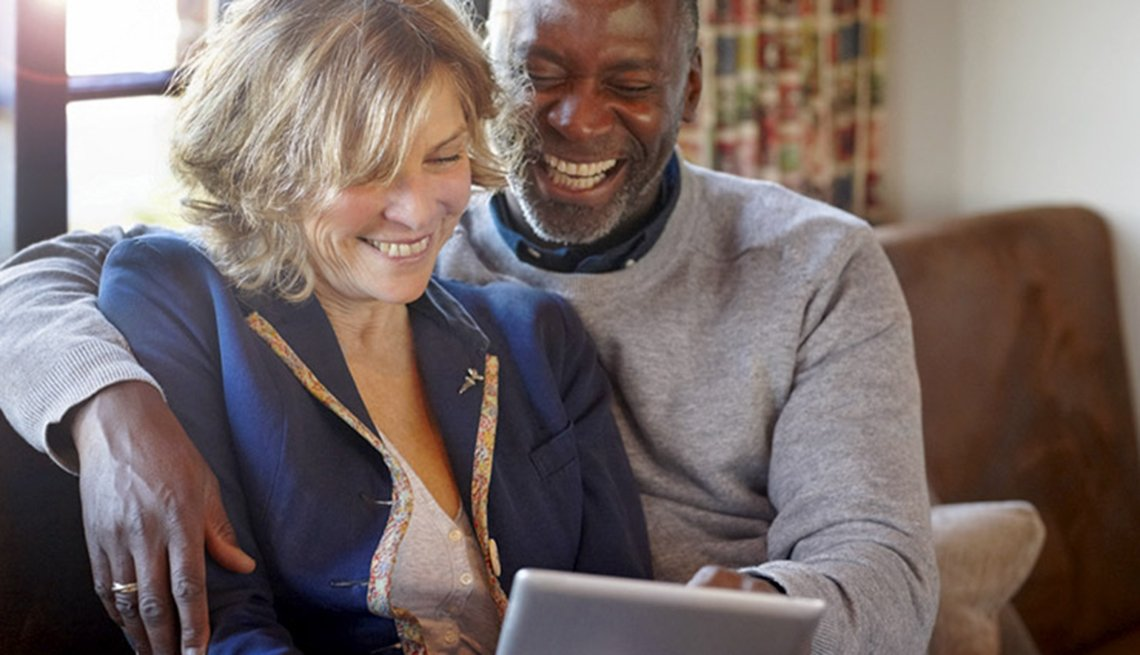 Woman and man using tablet at home, AARP's Medicare Q&A Tool