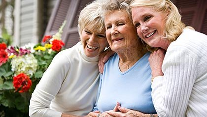 Senior mother and two daughters. Sibling relationships and caregiving.