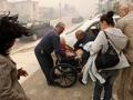 Mujer en silla de ruedas - Cómo prepararte ante un desastre natural