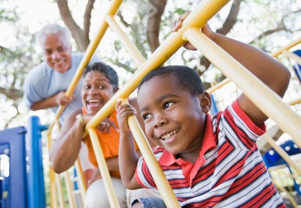Grandparents and grandson on playground equipment, Explore with a Schoolchild, Have Fun with Your Family & Friends This Summer (Kevin Dodge/Corbis)