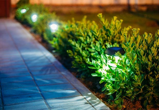 Solar-powered lights on a walkway, 10 Ways to Add a Curb Appeal to your Home