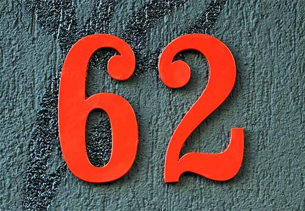 Large red house number that says