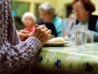 A senior woman during a meal at a nursing home. The cost of semi-private rooms in nursing homes are on the rise.