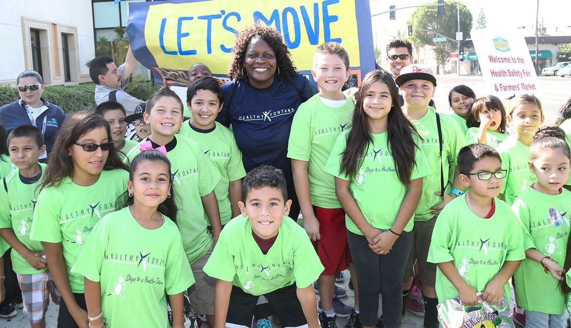 Fontana Mayor Acquanetta Warren joined by children participating in the annual Let's Move on the Trail Event
