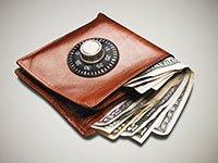 Billetera con dinero y cerradura de combinación - Manteniendo sus resoluciones sobre el dinero, ahorre más y gaste menos
