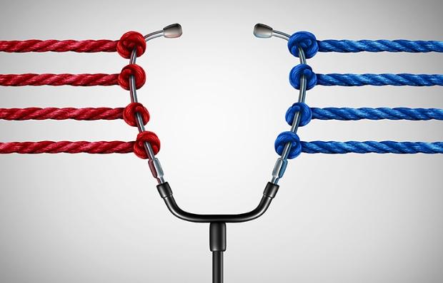 Estetoscopio atado con sogas rojas y azules - Votación de la nueva ley de salud