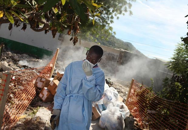 Hospital workers burn medical waste behind a hospital that is treating cholera patients, 10 effects of climate change