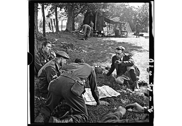 British and Canadian war correspondents with a local official, near Saint-Malo; Ille-et-Vilaine, Brittany, August 8, 1944.