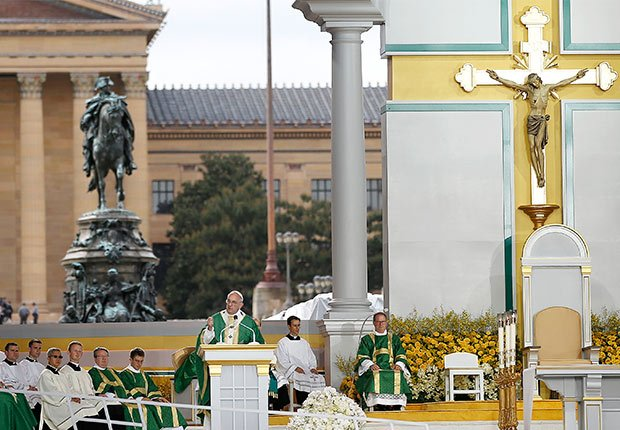 Pope Francis, center, delivers his homily while celebrating Mass Sunday, Sept. 27, 2015, in Philadelphia.