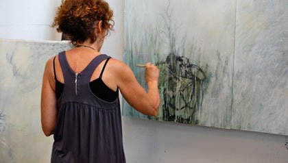 woman creates expressive drawing