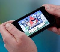 The ''Angry Birds'' mobile-phone game being played on an iPhone