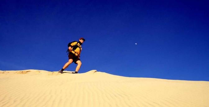 Man hiking on Kelso Dunes, Mojave National Preserve, California
