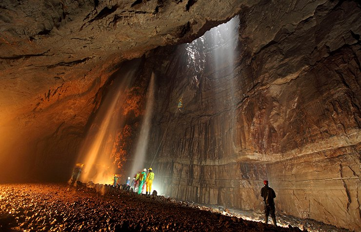 Team of people exploring a cave