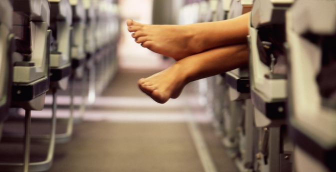 Woman's feet in airplane aisle.